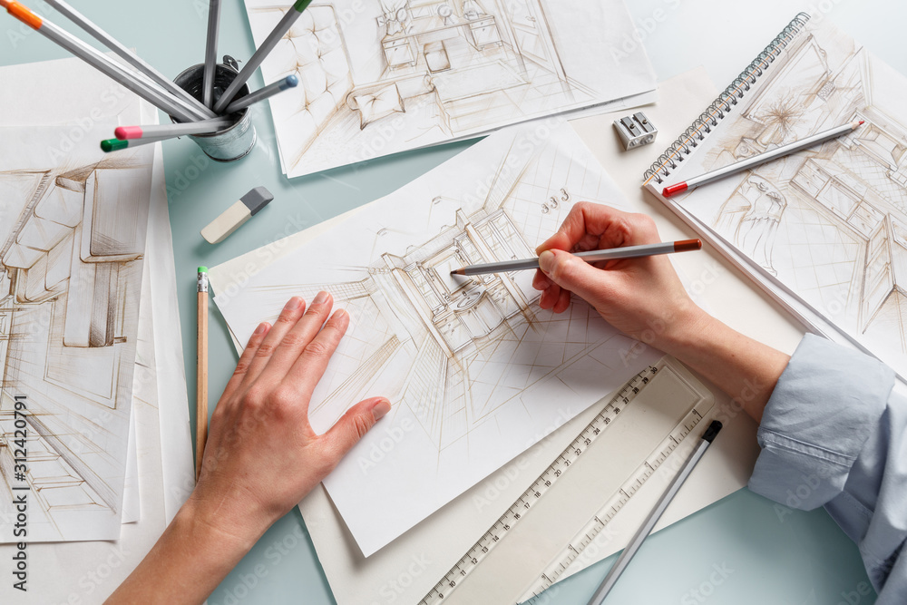 Fototapeta Interior designer making hand drawing pencil sketch of a bathroom