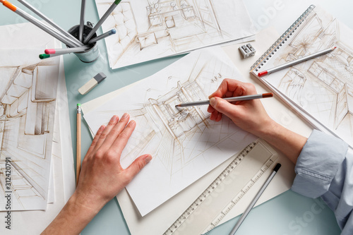Fototapeta Interior designer making hand drawing pencil sketch of a bathroom obraz