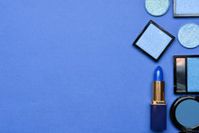 Set Of Blue Makeup Cosmetics On Color Background