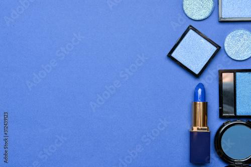Set of blue makeup cosmetics on color background Fototapet