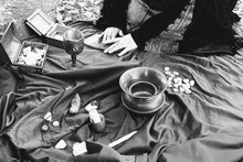 Solitary Witch Preparing An Altar