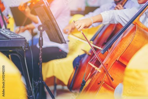 Fotografía  Musician is practicing cello in a music practice classroom prepare for performing violin stage