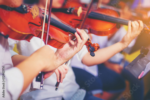 Fotografie, Obraz Musician is practicing violin in a music practice classroom prepare for performing violin stage