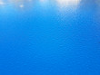canvas print picture - Blue surface covered in water droplets