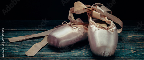 Pointes ballet shoes. Against a dark background. Wallpaper Mural