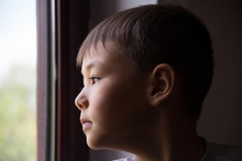 Portrait Of A Child At Home By...