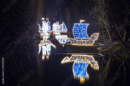 Fototapeta Christmas illumination at city park of Gdansk, Poland obraz na płótnie