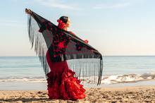 Young Spanish Woman Dancing Flamenco On The Beach