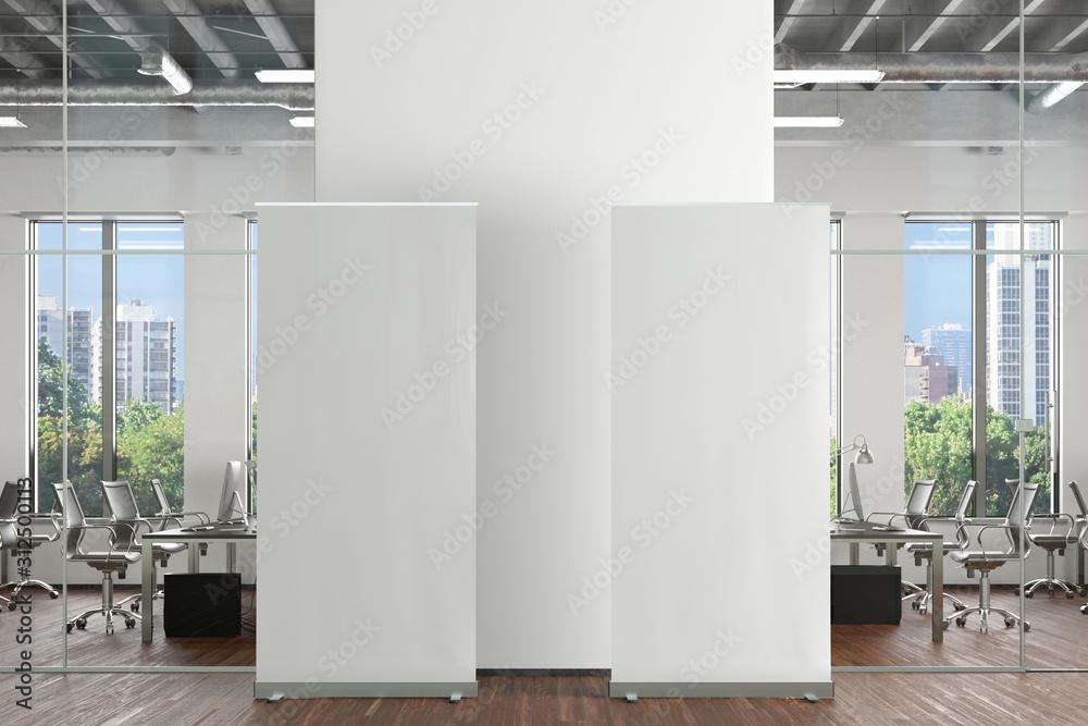Fototapeta Blank roll up banner stand in office interior. 3d illustration