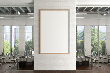Blank Vertical Poster Mock Up On The White Brick Wall In Office Interior. 3d Illustration