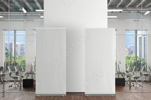 Fototapeta Blank roll up banner stand in office interior. 3d illustration obraz