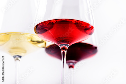 Obraz na plátně Three glass of red, rose and white wine isolated over white background