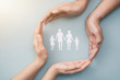 canvas print picture - Family care concept. Hands with paper silhouette on table.
