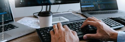 Fotografía  Programmer Typing Code on desktop computer, Developing programming and coding technologies concept