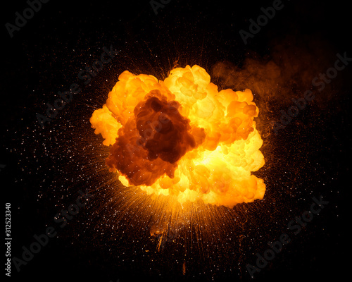 Fototapeta Fiery bomb explosion with sparks isolated on black background