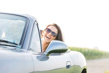 Excited Woman Enjoying Road Tr...