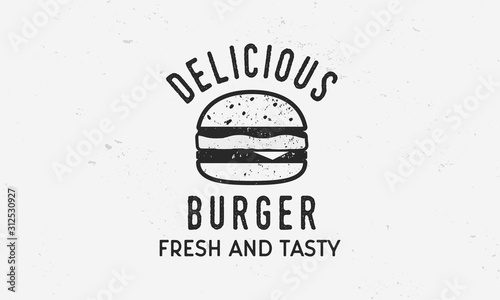 Fototapeta Delicious Burger - vintage logo template with burger silhouette and grunge texture. Vector illustration obraz