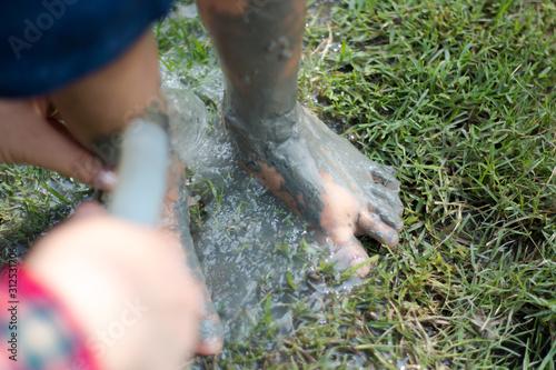 Fotografija  Washing dirty feet with water