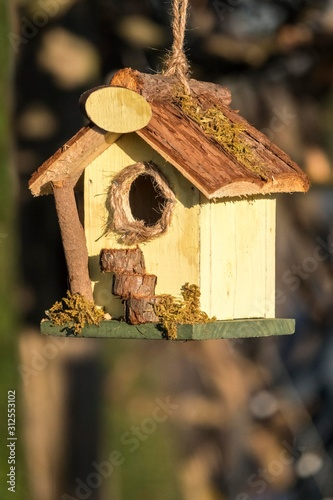 cute birdhouse in the garden Wallpaper Mural
