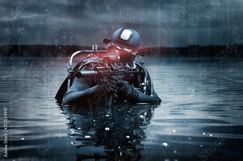 Fotomural SWAT unit soldier stands waist-deep in water with a machine gun in his hands