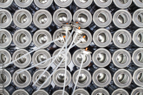 A large number of aerosol cans on a black background. Wallpaper Mural
