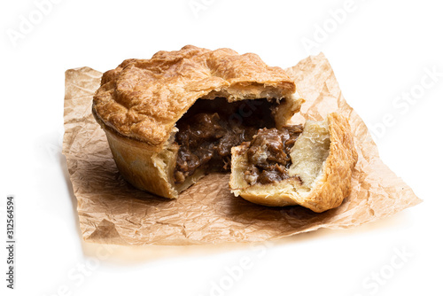 Puff pastry steak pie on baking paper isolated on white Fototapet