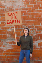 Woman With Poster Save The Earth