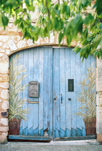 Blue Wooden Gate With Mailbox