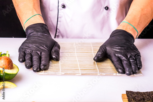 Fototapeta Chef cooks maki in stages obraz na płótnie