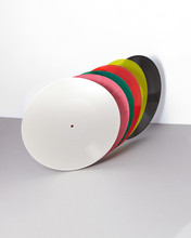 Multicolored Vinyl Records Collection On A Duotone Gray Background.