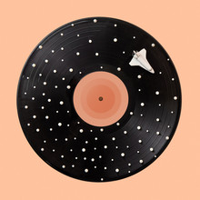 Black Vinyl Record With White Spots Stars And Space Ship On A Beige Background.
