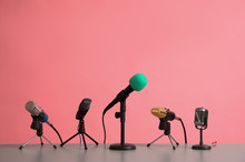 Microphones On Table Against P...