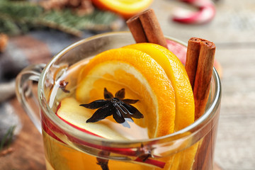Delicious aromatic mulled wine on table, closeup