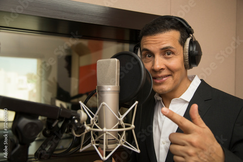 actor and radio announcer with headphones and microphone working film dubbing, p Canvas Print
