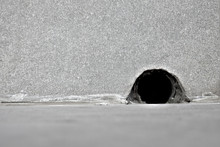 A Mouse Hole In A Wall.