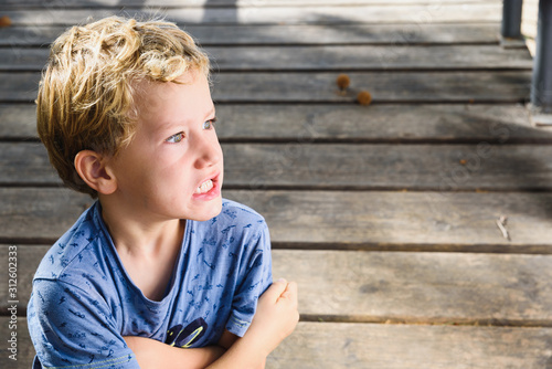 Fototapeta Portrait of 6 year old boy with expression on his face in anger and surprise. obraz