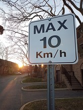 Max 10 KM/H Sign At Sunset Bes...