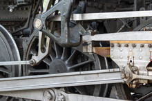 The Silver And Black Metal Shine In A Close Up Of A Steam Engine Wheel