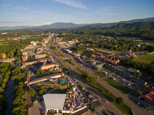The Setting Sun Cast Bright Highlights On The Various Attractions Of Pigeon Forge Tennessee. A Drone, Birds Eye, Aerial Angled View.