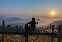 Silhouette The Sunrise With A Wooden Skywalk, The Fog, The Beautiful Sky And Cloud At Phu Lam Duan Mountain, Pak Chom District, Loei Province, Thailand.