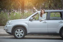 Selective Focus Of Excited Woman Waving Hand While Sitting In Car