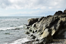 Seawaves Pounding Rock Formation On Ocean Waterfront