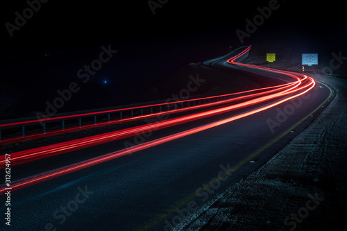 highway long exposure vehicle light trails curvy highway between mountains eilat Fotobehang
