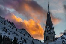 Church Steeple With Snowy Moun...