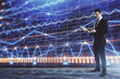 Businessman and forex graph hologram. Double exposure. Concept of financial education and analysis