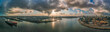 canvas print picture - Panoramic drone aerial view of port of Hamburg from Hafencity before sunset with dramatic stormy clouds