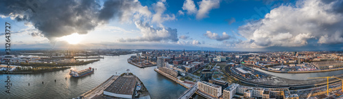 Cuadros en Lienzo Aerial drone panoramic view of port of Hamburg from above before sunset with dra