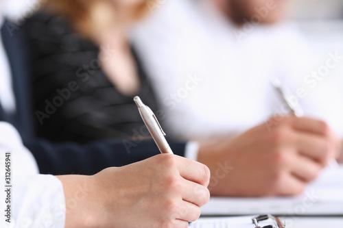 Fototapeta Group of people hold silver pen ready to make obraz na płótnie