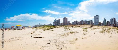 Dunas de areia e o céu azul com nuvens na Praia Grande, cidade de Torres, estado Canvas Print
