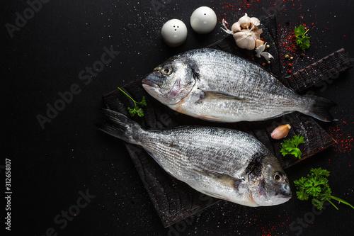 Fotografie, Obraz  Fresh dorado fish with ingredients